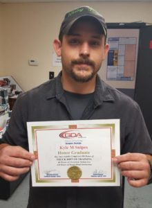 photo of GDA honor graduate Kyle Snipes with his graduate certificate
