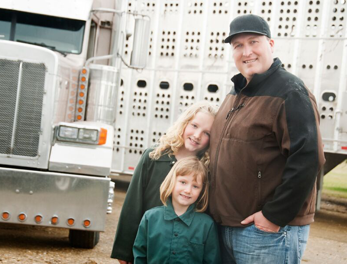 A trucker and his two daughters.