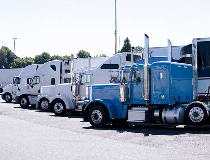 Commercial trucks lined up at an agle.