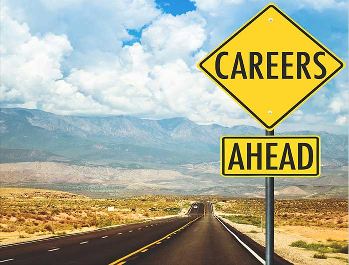 A road sign that shows careers ahead for truckers.