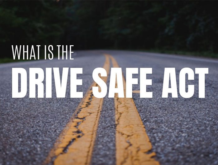 Drive Safe Act words on a road way.